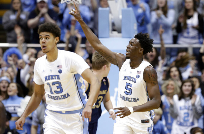 North Carolina's Nassir Little (5) celebrates a basket while running up the court with Cameron Johnson (13) during the second half of the team's NCAA college basketball game against Notre Dame in Chapel Hill, N.C., Tuesday, Jan. 15, 2019. North Carolina won 75-69. (AP Photo/Gerry Broome)