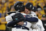 Seattle Mariners starting pitcher Felix Hernandez, right, hugs catcher Omar Narvaez as Hernandez leaves the team's baseball game against the Oakland Athletics during the sixth inning Thursday, Sept. 26, 2019, in Seattle, in Hernandez's final start of the season. (AP Photo/Ted S. Warren)