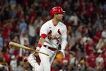 St. Louis Cardinals' Dylan Carlson tosses aside his bat as he watches his grand slam during the eighth inning of a baseball game against the San Diego Padres Friday, Sept. 17, 2021, in St. Louis. (AP Photo/Jeff Roberson)