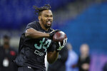FILE - In this March 1, 2020, file photo, Georgia Southern defensive back Kindle Vildor runs a drill at the NFL football scouting combine in Indianapolis, Sunday,. The Chicago Bears selected Vildor in the fifth round of the NFL football draft on Saturday, April 25, 2020. (AP Photo/Michael Conroy, File)