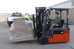 A Indiana National Guardsman loads a pallet of medical supplies into the back of a truck, Thursday, March 26, 2020, in Indianapolis. The medical supplies were being delivered to Indiana hospitals and health departments to help fight the coronavirus pandemic.  The new coronavirus causes mild or moderate symptoms for most people, but for some, especially older adults and people with existing health problems, it can cause more severe illness or death.(AP Photo/Darron Cummings)