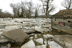FILE - In this Thursday, March 14, 2019 file photo, thick slabs of ice surround a structure in Fremont, Neb., after the Platte River flooded its banks. For years, states have relied heavily on the Federal Emergency Management Agency to pay the bulk of recovery efforts for damaged public infrastructure. While that remains the case, more states have been debating ways to supplement federal dollars with their own money dedicated not just to rebuilding but also to avoiding future flood damage. (AP Photo/Nati Harnik)