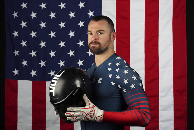 FILE - In this Sept. 26, 2017, file photo, United States bobsledder Carlo Valdes poses for a portrait at the 2017 Team USA Media Summit in Park City, Utah. Valdes, a member of the 2018 U.S. Olympic team, has announced that he is returning to the sport with hopes of making the team for the 2022 Beijing Games. (AP Photo/Rick Bowmer, File)