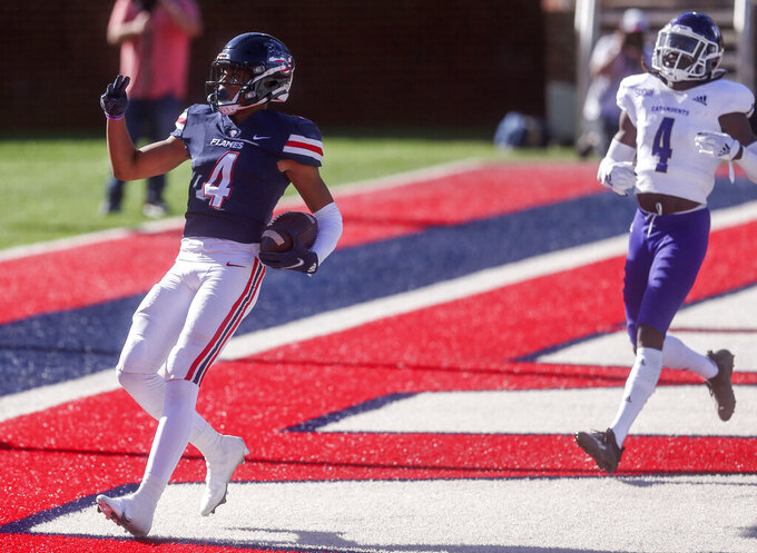 Liberty wide receiver CJ Daniels (4) scores a touchdown past Western Carolina  Safety A.J. Rogers (4) during the first half of an NCAA football game on Saturday, Nov. 14, 2020, in Lynchburg, Va. (AP Photo/Shaban Athuman)