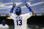 Kansas City Royals' Salvador Perez celebrates his solo home run during the fourth inning of a baseball game against the Minnesota Twins at Kauffman Stadium in Kansas City, Mo., Saturday, Aug. 8, 2020. (AP Photo/Orlin Wagner)