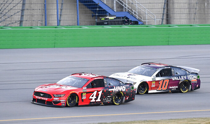 Daniel Suarez (41) tries to hold off Aric Almirola (10) during the NASCAR Cup Series auto race at Kentucky Speedway in Sparta, Ky., Saturday, July 13, 2019. (AP Photo/Timothy D. Easley)