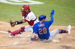 New York Mets J.D. Davis (28) slides safe to home beating the catch from Washington Nationals catcher Kurt Suzuki, left, during the fourth inning of a baseball game in Washington, Wednesday, Aug. 5, 2020. (AP Photo/Manuel Balce Ceneta)
