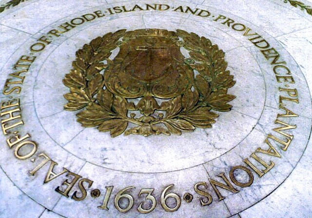 FILE - This Jan. 21, 2000 file photo shows the seal of the State of Rhode Island and Providence Plantations on the floor of the Statehouse rotunda in Providence, R.I. On Thursday, July 16, 2020, state lawmakers approved placing a question on the November ballot to allow voters the option to remove