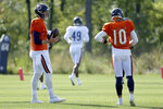 Chicago Bears quarterbacks Nick Foles (9) and Mitchell Trubisky (10) participate in a drill during NFL football training camp at Halas Hall on Wednesday, Sept. 2, 2020, in Lake Forest, Ill. (Dylan Buell/Pool Photo via AP)
