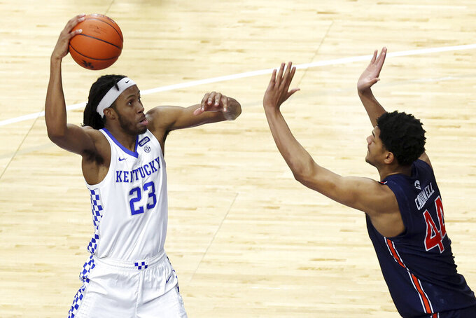 Kentucky's Isaiah Jackson (23) goes up for a dunk over Auburn's Dylan Cardwell during the second half of an NCAA college basketball game in Lexington, Ky., Saturday, Feb. 13, 2021. (AP Photo/James Crisp)