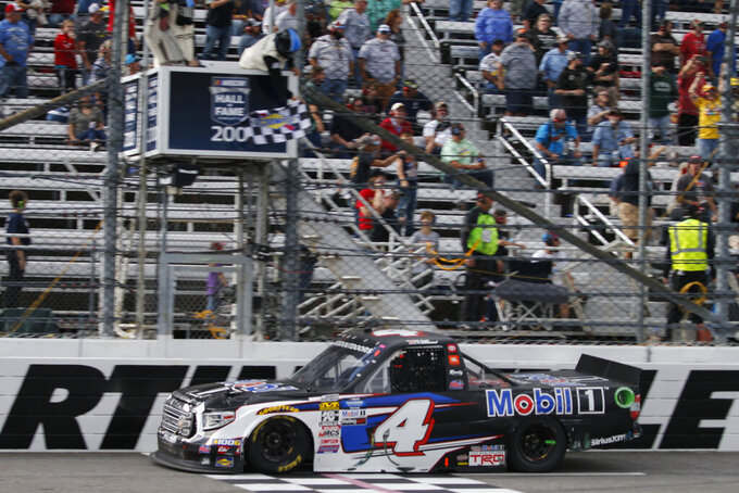 Todd Gilliland (4) crosses the finish line to win the NASCAR Truck Series race at Martinsville Speedway in Martinsville, Va., Saturday, Oct. 26, 2019, (AP Photo/Steve Helber)