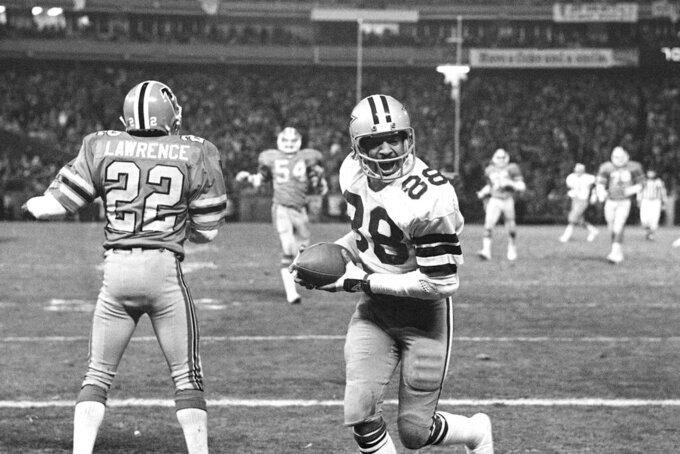 FILE - In this Jan. 4, 1981, file photo, Dallas wide receiver Drew Pearson (88) celebrates scoring the winning touchdown in the final minutes against the Atlanta Falcons in NFC divisional playoff football game in Atlanta.  NFL champion players Roger Craig, Drew Pearson and Donnie Shell are among the finalists for the Pro Football Hall of Fame's special centennial class announced Thursday, Dec. 19, 2019. A 25-member panel of pro football experts is charged with selecting 10 senior players, two coaches and three contributors who will be inducted into the Canton, Ohio shrine next year as part of the league's celebration of its 100th season. (AP Photo/File)