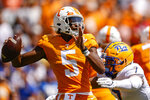 Tennessee quarterback Hendon Hooker (5) throws to receiver as he's hit by Pittsburgh linebacker SirVocea Dennis (7) during the first half of an NCAA college football game Saturday, Sept. 11, 2021, in Knoxville, Tenn. (AP Photo/Wade Payne)