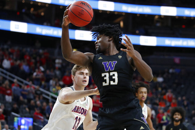 Washington's Isaiah Stewart (33) grabs a rebound over Arizona's Stone Gettings (13) during the first half of an NCAA college basketball game in the first round of the Pac-12 men's tournament Wednesday, March 11, 2020, in Las Vegas. (AP Photo/John Locher)