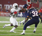UNLV running back Charles Williams looks to run past Fresno State defensive back Evan Williams during the first half of an NCAA college football game in Fresno, Calif., Friday, Sept. 24, 2021. (AP Photo/Gary Kazanjian)