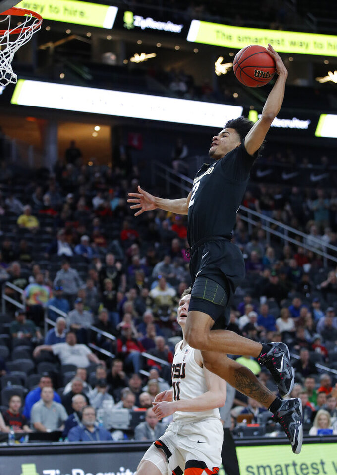 Colorado's Daylen Kountz, top, dunks against Oregon State during the first half of an NCAA college basketball game in the quarterfinal round of the Pac-12 men's tournament Thursday, March 14, 2019, in Las Vegas. (AP Photo/John Locher)