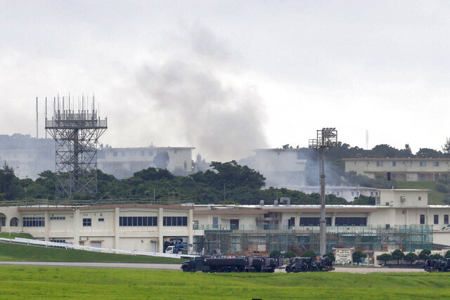 Smoke rises from at the 18th Wing Hazardous Materials Pharmacy building at Kadena Air Base during a fire on Okinawa island, Japan, Monday morning, June 22, 2020. Cause of fire is unknown, no injuries are reported. (Kyodo News via AP)