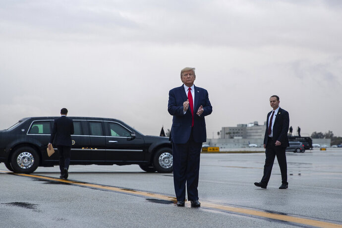 President Donald Trump pauses as he arrives at Miami International Airport en route to attend the Republican National Committee winter meetings, Thursday, Jan. 23, 2020, in Miami. (AP Photo/ Evan Vucci)