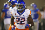 Boise State running back Alexander Mattison heads to the bench after scoring a touchdown against Air Force in the second half of an NCAA college football game Saturday, Oct. 27, 2018, at Air Force Academy, Colo. (AP Photo/David Zalubowski)