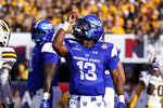 Georgia State quarterback Dan Ellington (13) reacts after scoring a touchdown against Wyoming during the first half of the Arizona Bowl college football game Tuesday, Dec. 31, 2019, in Tucson, Ariz. (AP Photo/Rick Scuteri)