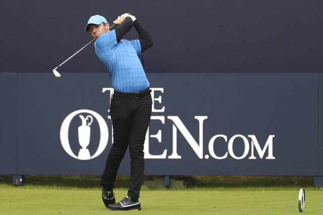 FILE - In this July 18, 2019, file photo, Northern Ireland's Rory McIlroy hits his tee shot on the first hole during the first round of the British Open Golf Championships at Royal Portrush in Northern Ireland. McIlroy's opening shot in the first major in his home country in 68 years went out-of-bounds. (AP Photo/Peter Morrison, File)