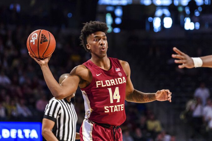 Florida State guard Terance Mann (14) passes the ball during the first half of an NCAA college basketball game against Georgia Tech Saturday, Feb. 16, 2019, in Atlanta. (AP Photo/Danny Karnik)