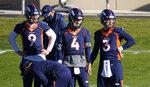 Denver Broncos quarterbacks Drew Lock, Brett Rypien and Jeff Driskel, from right, watch during the NFL football team's practice Wednesday, Nov. 11, 2020, in Englewood, Colo. (AP Photo/David Zalubowski)