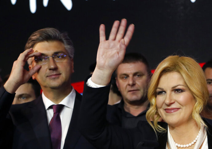 Incumbent president and presidential candidate Kolinda Grabar Kitarovic waves to her supporters in Zagreb, Croatia, Sunday, Jan. 5, 2020. A leftist Zoran Milanovic challenger won Croatia's highly contested presidential election on Sunday, beating a conservative incumbent — a rare victory by a liberal in recent votes in Central Europe. (AP Photo/Darko Vojinovic)