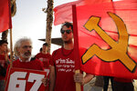 People protest against the conference in Bahrain, which focuses on the economic portion of the White House's long-awaited plan for Mideast peace, in Tel Aviv, Israel, Tuesday, June 25, 2019. At this week's conference, the Trump administration hopes to draw pledges from business leaders and wealthy Gulf states to fund its economic plan, which calls for $50 billion of investment and infrastructure projects in the West Bank, Gaza and neighboring Arab countries.(AP Photo/Sebastian Scheiner)
