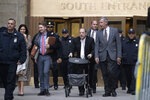 Harvey Weinstein uses a walker as he leaves a Manhattan courthouse after a day in his trial on rape and sexual assault charges, Thursday, Jan. 23, 2020, in New York. (AP Photo/Mark Lennihan)