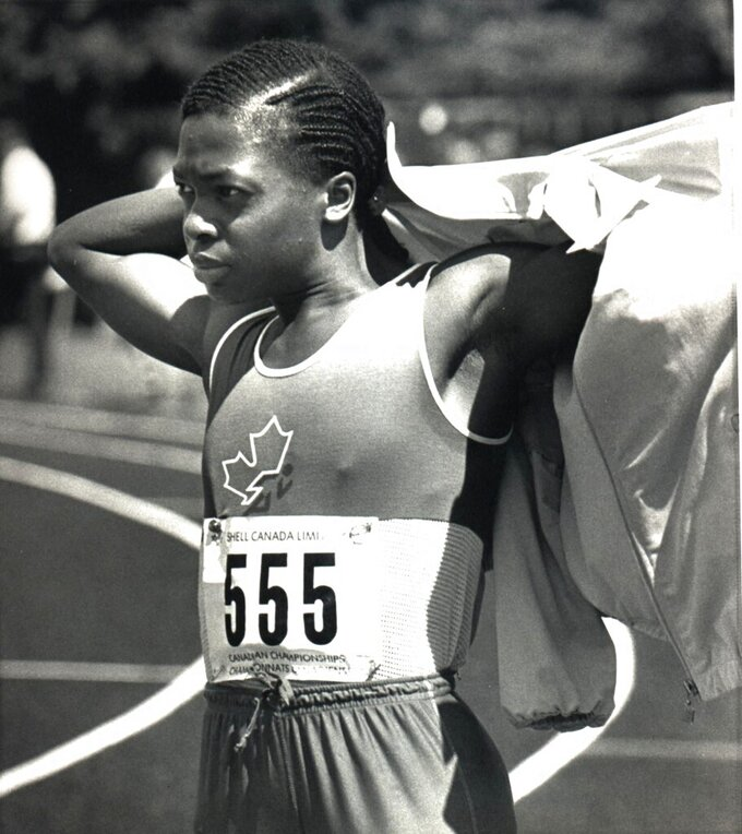 FILE - In this Aug. 2, 1985, file photo, Angela Bailey is shown the National Track and Field Championships in Ottawa. Bailey, the Canadian women's record holder in the 100 meters and an Olympic 4x100 relay silver medalist, died Sunday, Aug. 1, 2021, at her home in Missisauga, Ontario. She was 59. Bailey's record time of 10.98 seconds in the 100 for Canadian women was set in 1987 and still stands. (Peter Jones/The Canadian Press via AP, File)