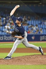 Tampa Bay Rays' Pete Fairbanks pitches to a Toronto Blue Jays batter during the sixth inning of a baseball game Tuesday, Sept. 14, 2021, in Toronto. (Jon Blacker/The Canadian Press via AP)
