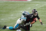 Carolina Panthers defensive end Marquis Haynes (98) sacks Atlanta Falcons quarterback Matt Ryan (2) during the first half of an NFL football game, Sunday, Oct. 11, 2020, in Atlanta. (AP Photo/Brynn Anderson)