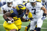 Michigan running back Karan Higdon (22) rushes in the first quarter of an NCAA college football game against Penn State in Ann Arbor, Mich., Saturday, Nov. 3, 2018. (AP Photo/Tony Ding)