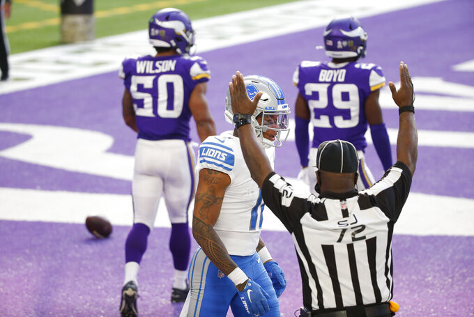 Detroit Lions wide receiver Marvin Jones Jr. (11) celebrates after scoring on a 15-yard touchdown reception during the first half of an NFL football game against the Minnesota Vikings, Sunday, Nov. 8, 2020, in Minneapolis. (AP Photo/Bruce Kluckhohn)