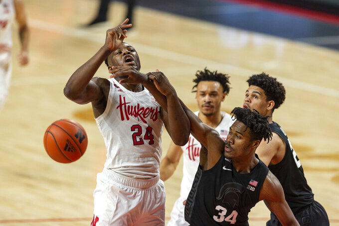 Nebraska forward Yvan Ouedraogo (24) receives a foul from Michigan State forward Julius Marble II (34) in the first half during an NCAA college basketball game on Saturday, Jan., 2, 2021, in Lincoln, Neb. (AP Photo/John Peterson)