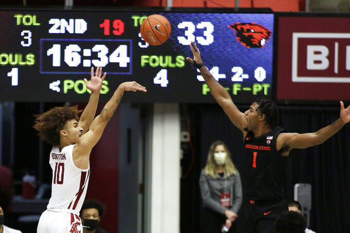 Washington State guard Isaac Bonton (10) shoots over Oregon State forward Maurice Calloo (1) during the second half of an NCAA college basketball game in Pullman, Wash., Wednesday, Dec. 2, 2020. Washington State won 59-55. (AP Photo/Young Kwak)