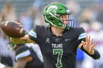 Tulane quarterback Michael Pratt (7) throws a pass during an NCAA college football game against SMU in New Orleans, Friday, Oct. 16, 2020. (AP Photo/Matthew Hinton)