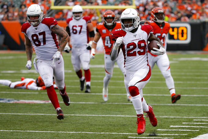 Arizona Cardinals running back Chase Edmonds (29) runs for a touchdown in the second half of an NFL football game against the Cincinnati Bengals, Sunday, Oct. 6, 2019, in Cincinnati. (AP Photo/Frank Victores)