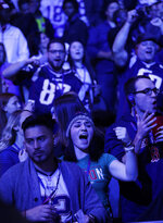 Fans cheer during Opening Night for the NFL Super Bowl 53 football game Monday, Jan. 28, 2019, in Atlanta. (AP Photo/David J. Phillip)