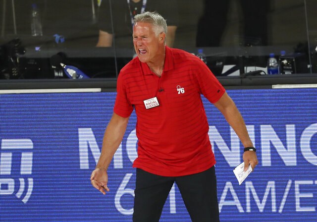 Philadelphia 76ers head coach Brett Brown reacts after receiving a technical foul during the third quarter of Game 4 of an NBA basketball first-round playoff series against the Boston Celtics, Sunday, Aug. 23, 2020, in Lake Buena Vista, Fla. (Kim Klement/Pool Photo via AP)