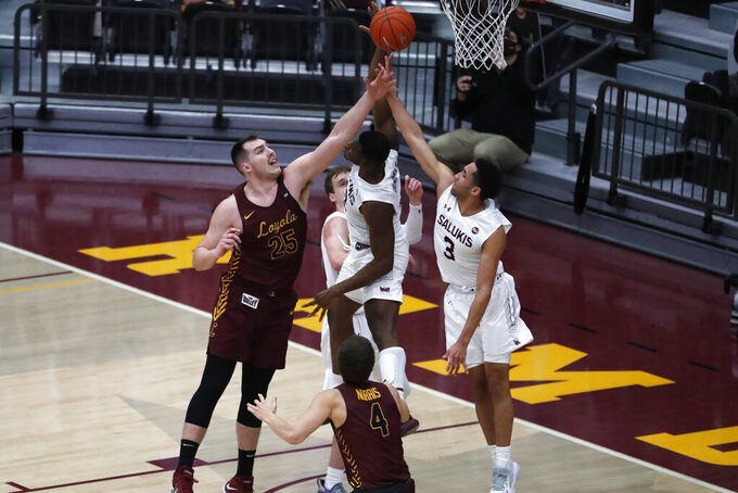 Loyola Chicago's Cameron Krutwig, left, Southern Illinois' Sekou Dembele, center, and Dalton Banks reach for a loose ball during the first half of an NCAA college basketball game Saturday, Feb. 27, 2021, in Chicago. (AP Photo/Shafkat Anowar)