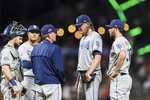 San Diego Padres pitching coach Darren Balsley, left, talks to relief pitcher Trey Wingenter before throwing against the San Francisco Giants during the seventh inning of a baseball game Tuesday, June 11, 2019, in San Francisco. (AP Photo/John Hefti)