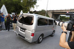 A car, which is believed to be carrying Vietnamese Doan Thi Huong, leaves a prison in Kajang, Malaysia, Friday, May 3, 2019.  A Vietnamese embassy translator says the Vietnamese woman who was tried for the killing of the estranged half brother of North Korea's leader has been released from a Malaysian prison.(AP Photo/Vincent Thian)