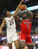 St. Francis forward Myles Thompson (5) is fouled by Virginia guard Trey Murphy III (25) during an NCAA college basketball game, Tuesday, Dec. 1, 2020 in Charlottesville, Va. (Andrew Shurleff/The Daily Progress via AP)