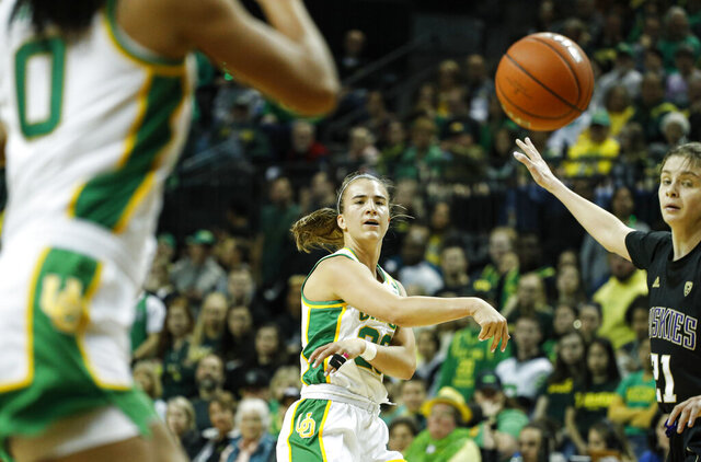 Oregon guard Sabrina Ionescu (20) passes inside against Washington during an NCAA college basketball game in Eugene, Ore., Sunday, March 1, 2020. (AP Photo/Thomas Boyd)
