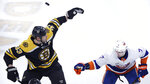 Boston Bruins defenseman Zdeno Chara (33) and New York Islanders right wing Jordan Eberle (7) try to knock down a flying puck during first period of an NHL hockey game in Boston, Tuesday, Feb. 5, 2019. (AP Photo/Charles Krupa)