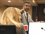 Sigfredo Garcia's lead defense attorney Saam Zangeneh points at Assistant State Attorney Georgia Cappleman as he shares his closing arguments Thursday, Oct. 10, 2019. A Florida jury on Thursday began deliberating the fates of a man and woman facing murder charges in the killing of Florida State University law professor, who was entangled in a messy divorce and bitter child custody battle when he was gunned down five years ago in his garage. (Alicia Devine/Tallahassee Democrat via AP)