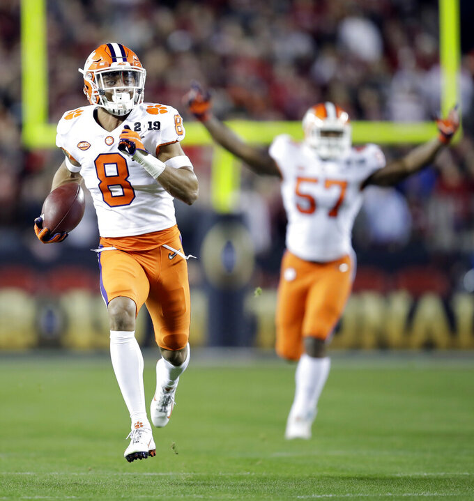 Clemson's A.J. Terrell intercepts a pass for a touchdown during the first half the NCAA college football playoff championship game against Alabama, Monday, Jan. 7, 2019, in Santa Clara, Calif. (AP Photo/Ben Margot)