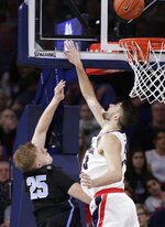 San Diego forward Yauhen Massalski (25) shoots while defended by Gonzaga forward Killian Tillie during the first half of an NCAA college basketball game in Spokane, Wash., Saturday, Feb. 2, 2019. (AP Photo/Young Kwak)